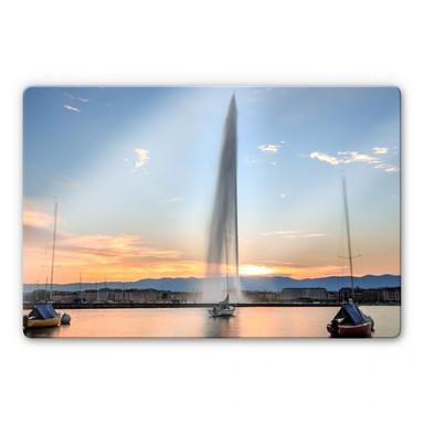 Glasbild Wasserfontäne im Genfer Sonnenuntergang