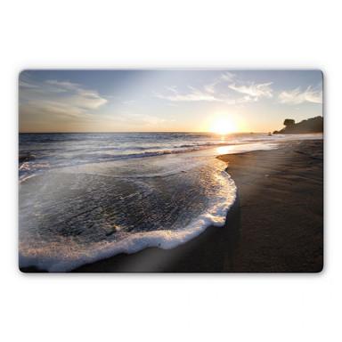 Glasbild Sonnenuntergang am Meer
