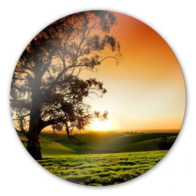 Glasbild Sonnenuntergang über den Hügeln - rund
