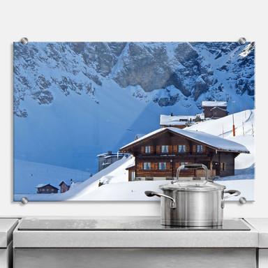 Spritzschutz Ferienhütte in den Schweizer Alpen